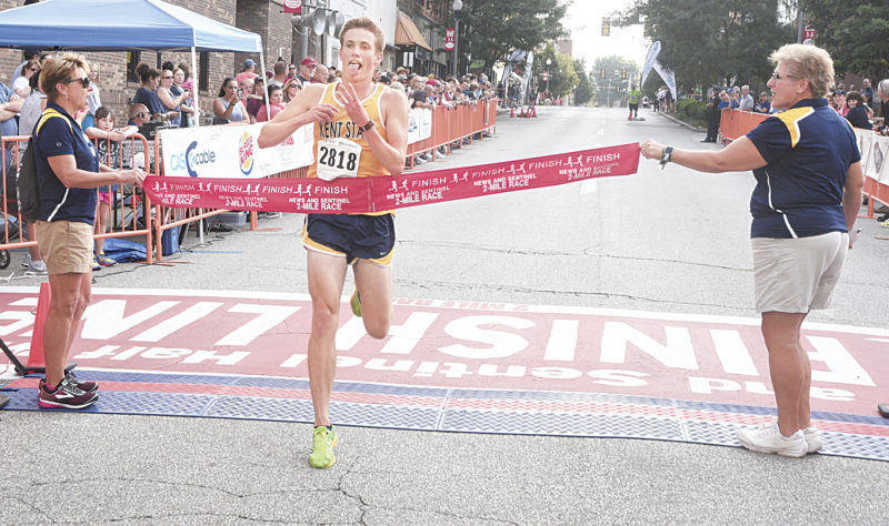 Photos by Jeff Baughan Kent State runner and Warren graduate Sam Goodman broke the tape in the male's 2-mile run for the third year in a row. He ran the course in 9:49, his first sub-10 minute time in the even, almost 40 seconds better than his closest competitor.
