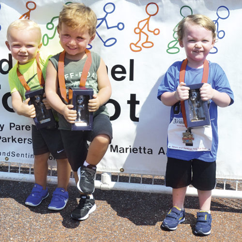 Photo by Ron Johnston The winner of the boys' two and under race Sunday at PHS Stadium Field from left to right: Bronson Farley, Noah Maher, Noah Reeder were first, second and third, respectively.