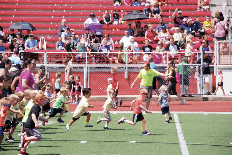 Photo by Art Smith  One of the Tiny Trot races gets underway Sunday at PHS Stadium Field.