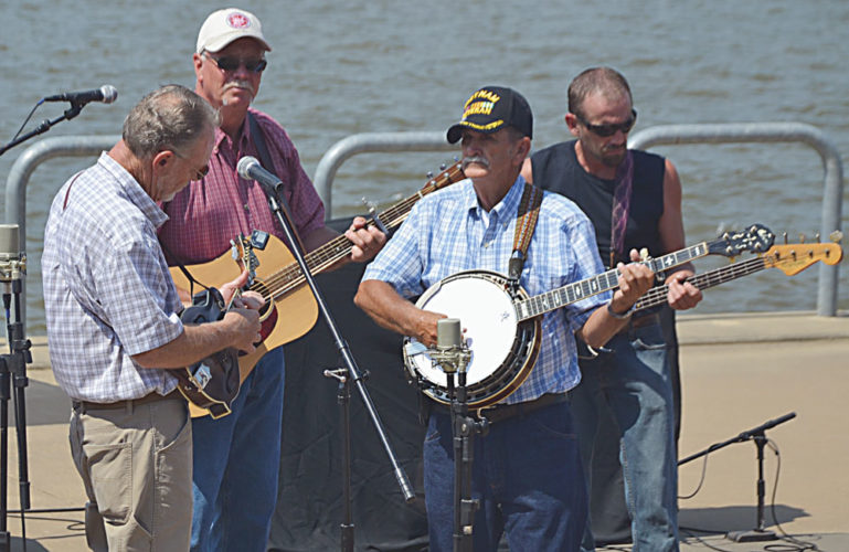Photo by Brett Dunlap Tunnel Hill performed Saturday during the 16th annual Johnny Staats Bluegrass Festival held at the Point Park Amphitheater.