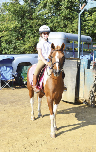 Photo by Doug Loyer Lyla Grell, 8, rides Rocky and gets ready to participate in the horse show at the Waterford Fair.