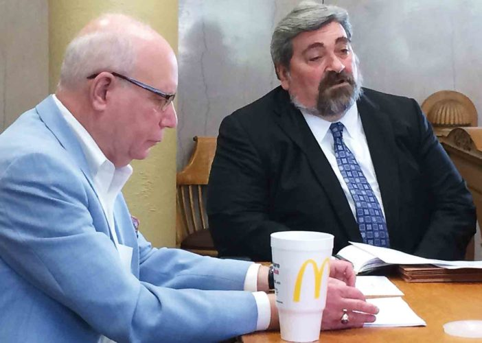 Attorney Dan Marshall, left, bond counsel for the Wood County Commission, and attorney Roger Hunter, right, of Bowles Rice, at Monday's meeting of the Wood County Commission. Hunter discussed the proposed refinancing of bonds for the Wood County Justice Center. (Photo by Brett Dunlap)