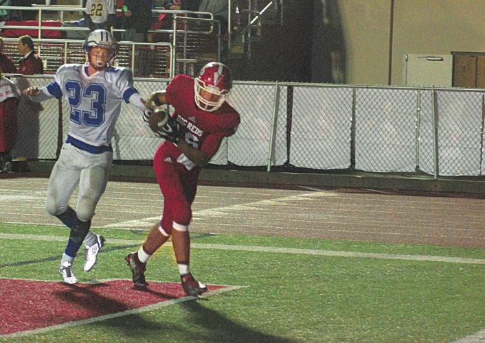 File Photo  Parkersburg High's Brenton Strange hauls in a touchdown catch over Warren's Bishop Ford last season.