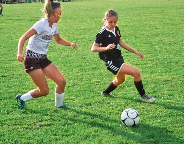 Photo by Ron Johnston  Williamstown's Shyla Watson, left, and Marietta defender Samantha Zumwalde battle for the ball Tuesday during the Tigers' 4-2 win over the Yellowjackets.