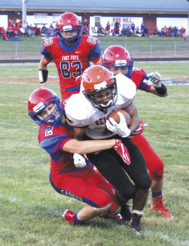 Fort Frye's Brady Schilling pulls down Belpre running back Tojzae Reams after a short gain during a high school football game Friday. Photo by Tom Perry.
