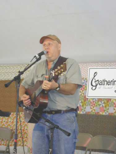 File Photo Musician Pete Kosky performs an original song at last year's Gathering at Sweet Creek near Mineral Wells.