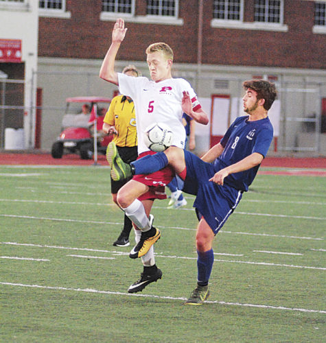 Warren's Zed Strahler (8) and PHS' Ian Domenick (5) battle for the ball in a soccer match Tuesday night at Stadium Fiekd that ended in a 1-1 tie. Photo by Steve Hemmelgarn