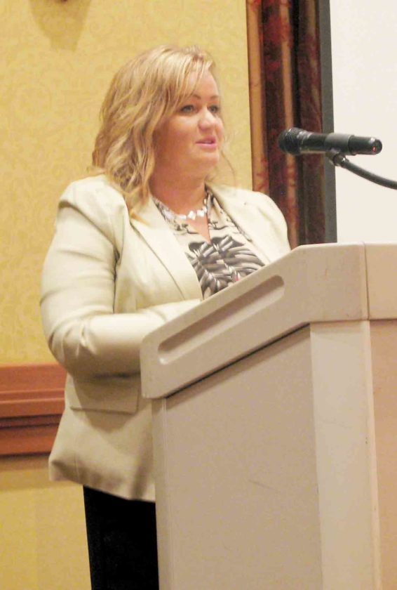 Stacy DeCicco, executive director of the United Way Alliance of the Mid-Ohio Valley, encourages the audience to raise $1,500 to buy 8,000 pounds of food for the Mountaineer Food Bank Tuesday morning during the Community Leaders Breakfast at the Grand Pointe Conference Center. (Photo by Jess Mancini)