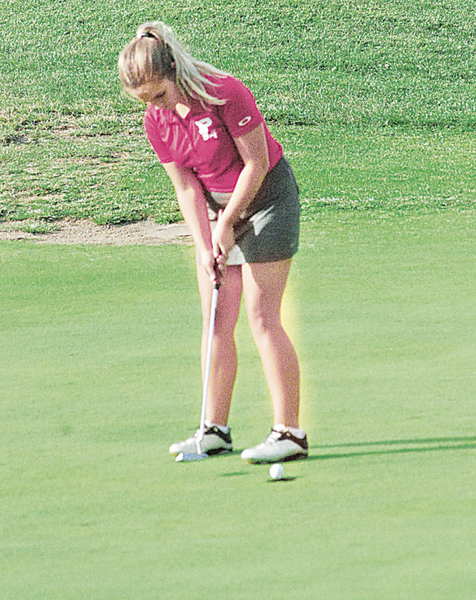 Parkersburg High's Nicole Lincicome lines up a putt during a golf tri match Wednesday at Woodridge Golf Club in Mineral Wells. Parkersburg South won, with Marietta second and PHS third. Photo by Steve Hemmelgarn