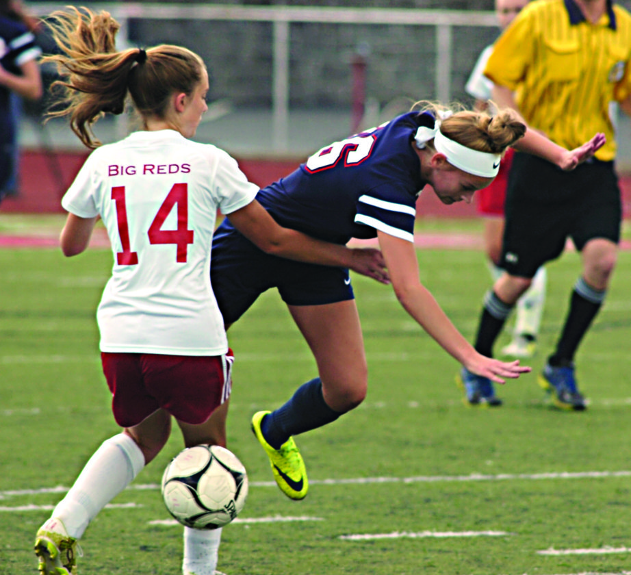 Photo by Joe Albright Parkersburg's Sarah Moise and Parkersburg South's Riley Pigott battle for control of the ball during the Patriots' 2-0 win over the Big Reds Saturday at PHS Stadium Field.