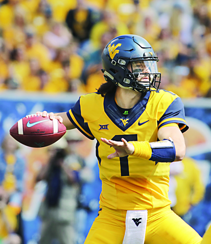 West Virginia quarterback Will Grier (7) attempts a pass during the first half of an NCAA college football game against East Carolina, Saturday, Sept. 9, 2017, in Morgantown, W.Va. (AP Photo/Raymond Thompson)