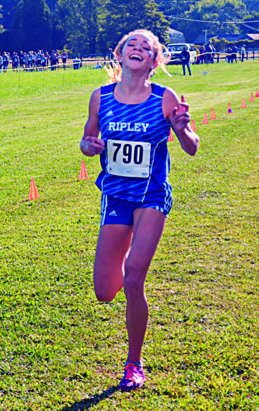 Ripley's Tori Starcher is the first girl to cross the finish line at Saturday's Chick-fil-A Invitational in Mineral Wells.   Photo by  Ron Johnston