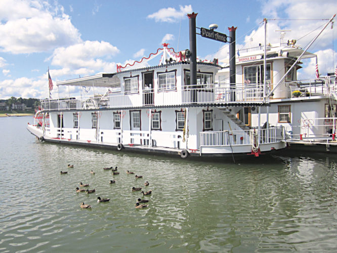 Photo by Wayne Towner A flock of ducks floats in the water next to the Pearl Anne.
