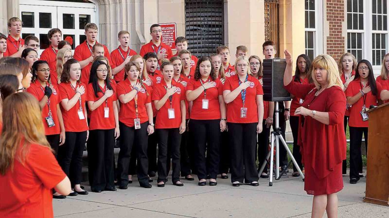 The Parkersburg High School A Cappella Choir, led by choir director Pamela McClain, sings the national anthem at Monday's 9-11 remembrance ceremony at PHS. (Photo by Michael Erb)
