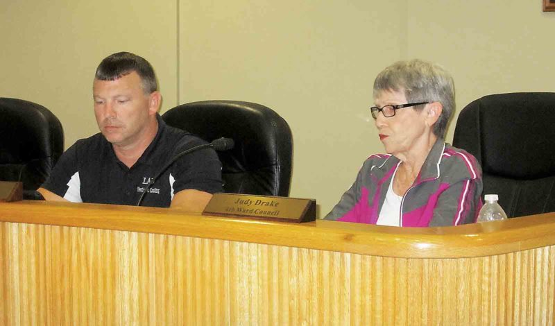 Belpre City Council members Daniel Law, left, and Judy Drake discuss issues at Monday's council meeting. (Photo by Wayne Towner)