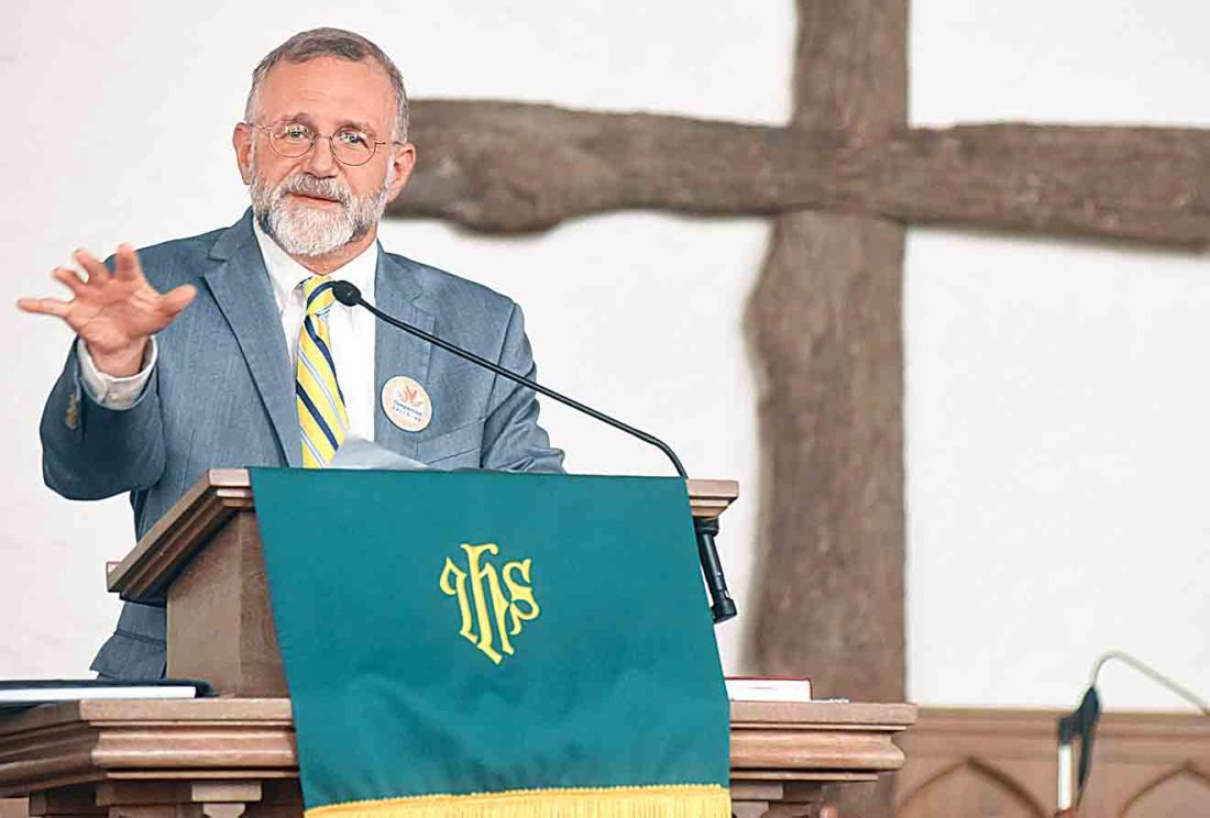 """The Rev. Jeff Allen, a United Methodist minister and executive director of West Virginia Council of Churches, speaks during the opening segment of Tuesday's """"Compassion Calls Us"""" event at First Christian Church in Parkersburg. (Photo by Jeff Baughan)"""