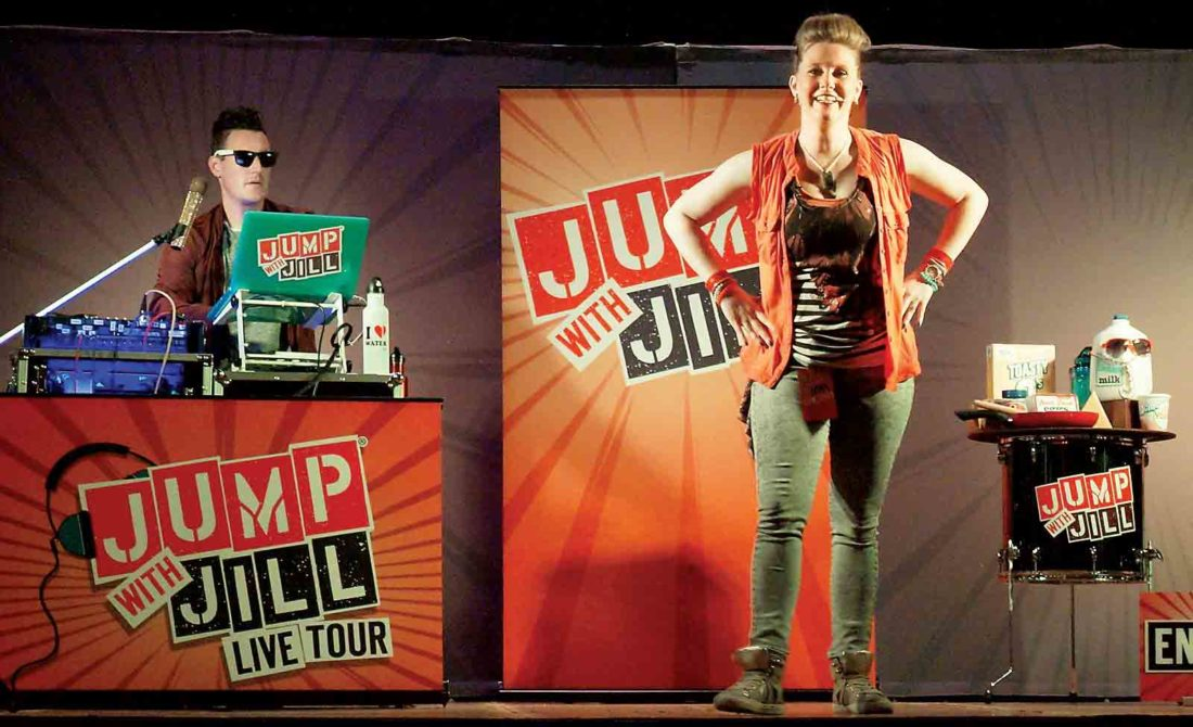 """""""Jump with Jill"""" star Jill (Hailey Zoccoli), right, and DJ Mark E. Mark (Mark Jayne), left, perform Tuesday for hundreds of first-graders at West Virginia University at Parkersburg. The """"Jump with Jill"""" show encourages activity and healthy nutrition through music and dance. (Photo by Michael Erb)"""