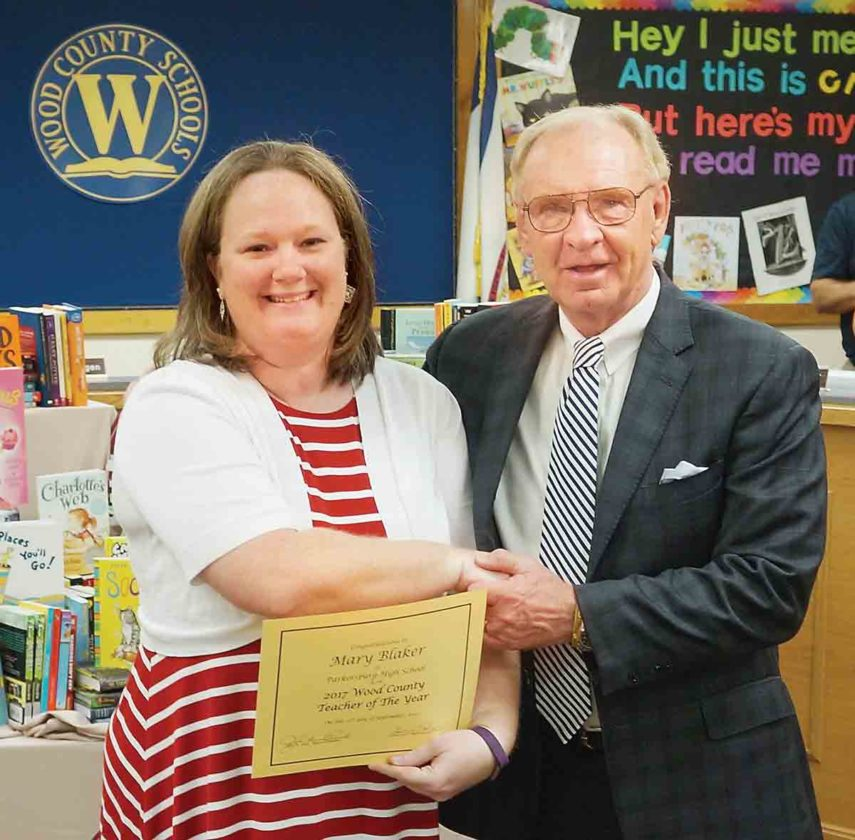 Wood County Schools Superintendent John Flint, right, presents Parkersburg High School teacher Mary Blaker with a certificate naming her as the Wood County Schools Teacher of the Year. (Photo by Michael Erb)