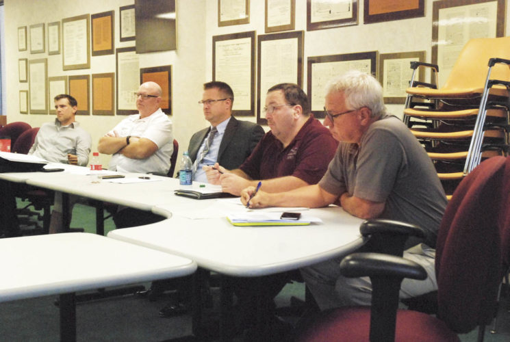 Photo by Evan Bevins Parkersburg City  Councilmen, from left, Eric Barber, Jeff Fox, Zach Stanley, Bob Mercer and John Reed  listen to discussion about the city's police and fire pension liabilities and how to fund them.