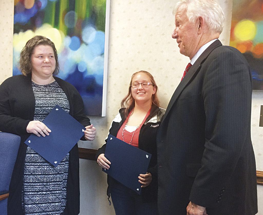 Photo by Brett Dunlap West Virginia University at Parkersburg President Fletcher Lamkin awards  certificates of appreciation to Autumn Henthorn and Tori Powell.