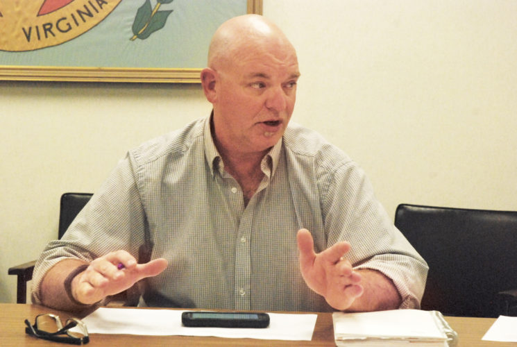 Photo by Evan Bevins Parkersburg City Councilman Jeff Fox discusses proposed fireworks regulations during a Public Works Committee meeting Tuesday at the Municipal Building.