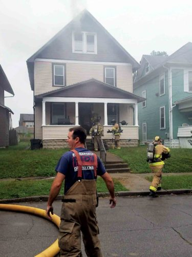 Parkersburg firefighters were dispatched to a fire at 1714 Oak St. at 8:58 a.m. Thursday as smoke billows from the attic. (Photo Provided)