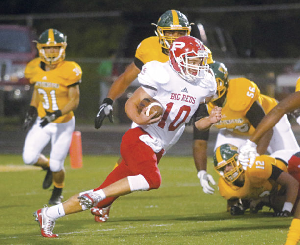 Larry Butcher/For The Herald-Dispatch Parkersburg's Jake Johnson (10) finds a running lane against Huntington during a West Virginia high school football game Friday, Setp. 15, 2017 at Bob Sang Field, at Huntington High School.