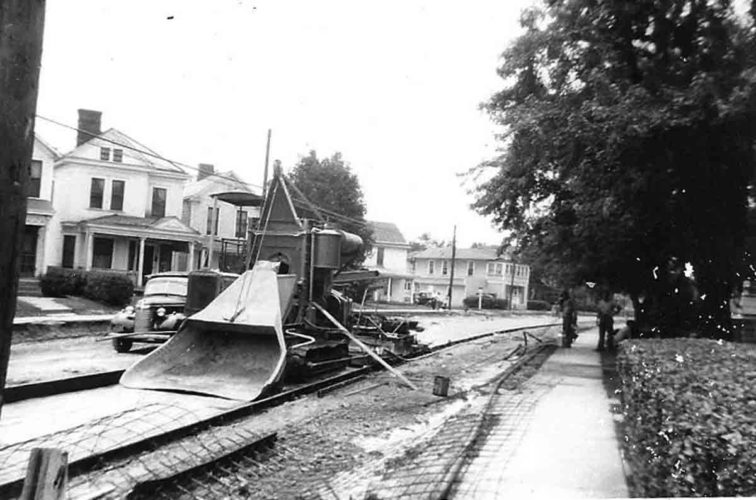 """The condition of streets and roadways in Parkersburg and Wood County have always been of utmost importance to the citizens and economy of the area.  The undated photo above shows an early """"paving"""" machine on what might be Seventh Street. (Photo from the WCHPS archives)"""
