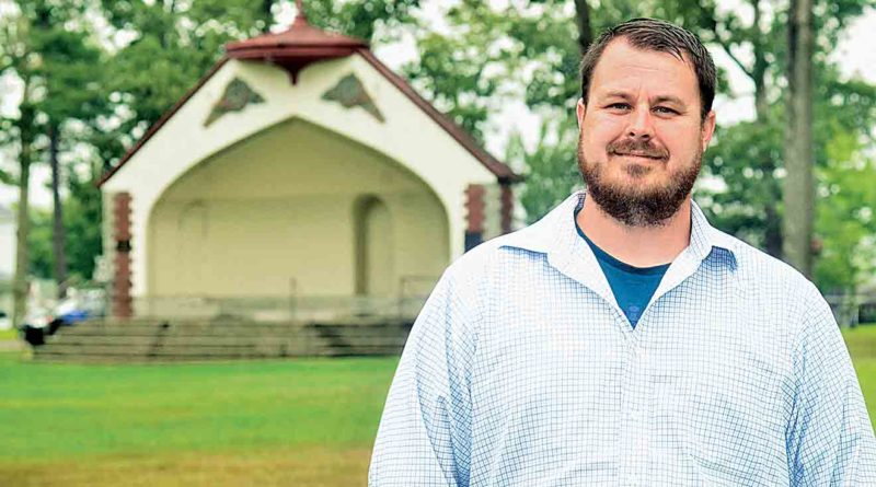 "Pastor Casey Dawson of the Sunrise Baptist Church is the moderator for the Parkersburg Baptist Association. He stands in front of the bandshell at Parkersburg's City Park where the Baptist Association is hosting the ""Party in the Park,"" which begins at  1 p.m. Sept. 30 with the Jason Lovins Band. (Photo by Jeff Baughan)"