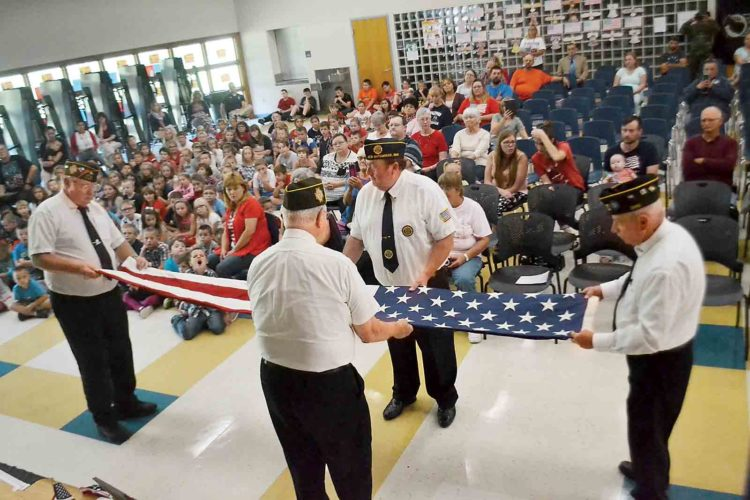 Photos by Michael Kelly Members of VFW Post 6387 ceremonially fold a flag at the National POW/MIA Day program Friday at Matamoras Elementary School. (Photo by Michael Kelly)