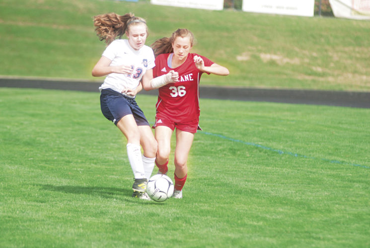 Photo by Jay W. Bennett Parkersburg South's Ellie Foggin and Hurricane's Abigail Fowler fight for the ball during Saturday morning's match inside the Erickson All-Sports Facility. The Redskins defeated the host Patriots, 1-0.