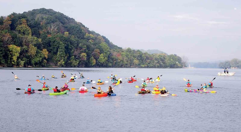 The Ohio River between Point Park and Blennerhassett Island was closed to commercial traffic for six hours Saturday to accommodate the fourth annual Parkersburg Paddlefest. (Photo by Wayne Towner)