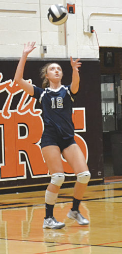 Parkersburg Catholic's Olivia Ullman serves during a high school volleyball game Monday at the Sutton Gym in Marietta. Photo by Ron Johnston.