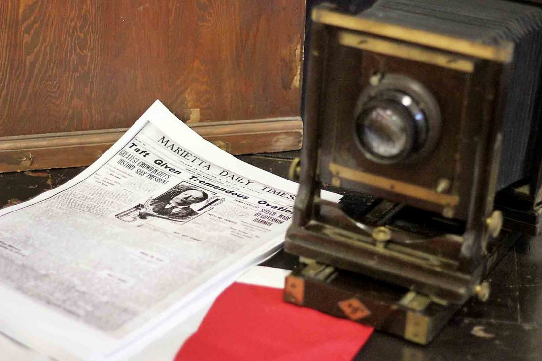 Art Smith provided copies for locals to take home of the front page of the Marietta Daily Times from June 15, 1910, following President William Howard Taft's visit. (Photo by Janelle Patterson)