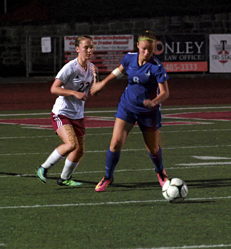 Photo by Steve Hemmelgarn Parkersburg High's Alexa Kotarski (23) battles for the ball with a Capital player Tuesday night at Stadium Field during a girls soccer game. The host Big Reds won, 3-1
