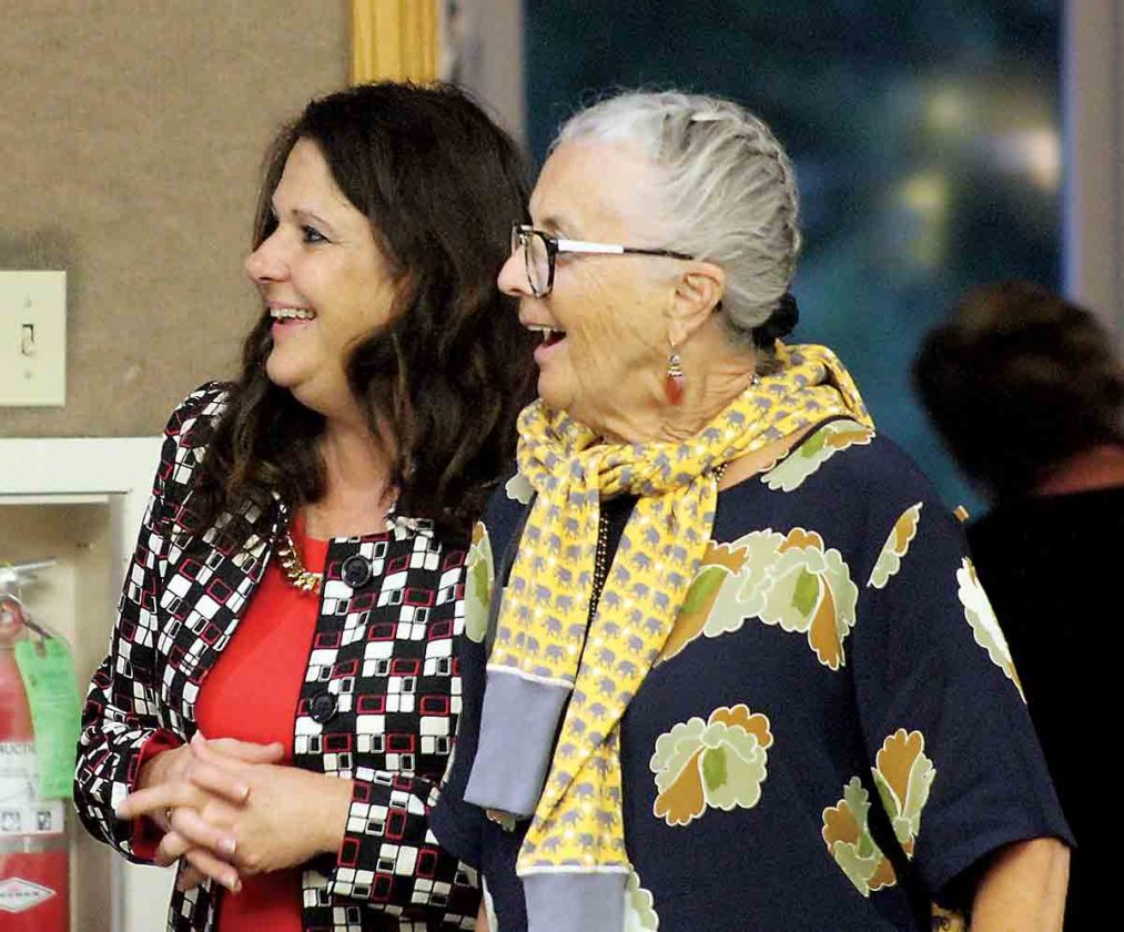 Marietta City Councilwoman Cindy Oxender, R-at large, left, and Sharon Adams share a laugh during the dessert auction at the Washington County Republicans Reagan Dinner Tuesday. (Photo by Janelle Patterson)