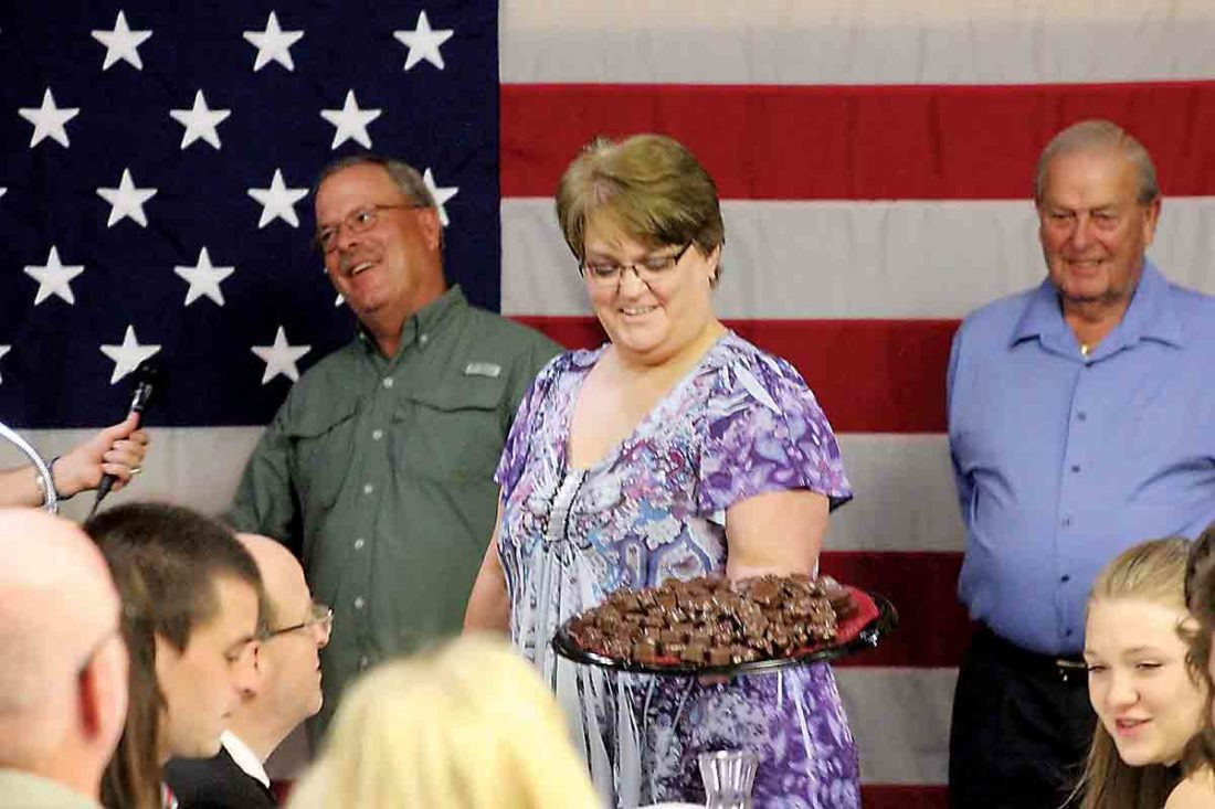 Belpre City Council Fourth Ward candidate Penne Riffle elicits bids in the dessert auction at the Washington County Republican Party Reagan Dinner at the Marietta Shrine Club Tuesday. (Photo by Janelle Patterson)
