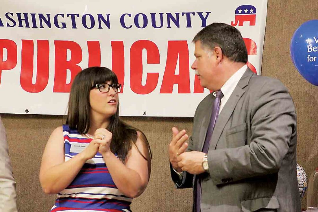 Cassidi Shoaf, left, candidate for one at-large seat in Marietta, and City Law Director Paul Bertram, who is running for Marietta Municipal Court judge, talk during the Washington County Republican Party Reagan Dinner at the Marietta Shrine Club Tuesday. (Photo by Janelle Patterson)
