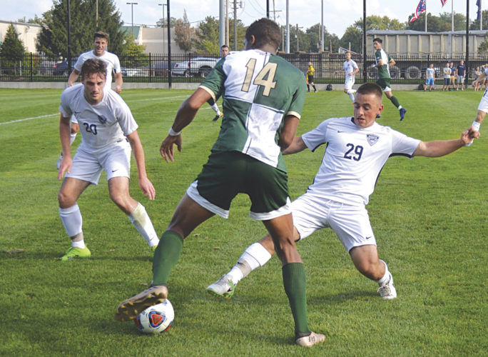 Marietta College's Noah Laliberty (20) and Alex Gruss (29) defend as Bethany College's Baboucar Sallah-Mohammed (14) tries to make a move with the ball. MC won 1-0 in 2 overtime  Photo by Ron Johnston.