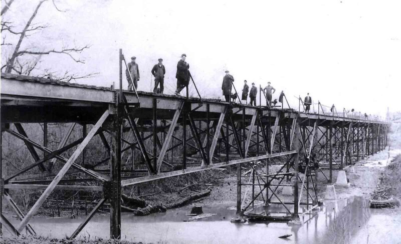 Photo Provided This 1907 photo shows the south approach of the East Street Bridge. In later years the original steel framework as seen above, was replaced, or covered, with earth.  The building of this bridge was a vital link for Parkersburg to Shattuck Park and the several industries that soon located along Camden Avenue in south Parkersburg.  Construction of the bridge was spearheaded by Charles H. Shattuck and Johnson Newlon Camden.