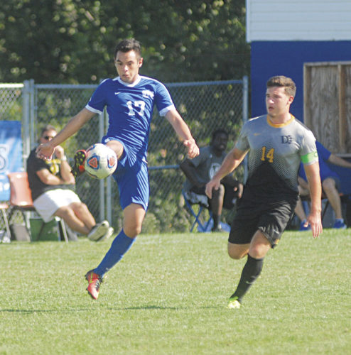 Ohio Valley University's Celso Riveros, who is shadowed by Ohio Dominican's Phillip Kelly, tallied a goal and had two assists to help lead the No. 18 Fighting Scots to a 5-2 victory Saturday afternoon against the visiting Panthers in Great Midwest Athletic Conference soccer action. Photo by Jay W. Bennett.