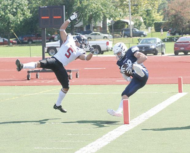 Marietta College's Andrew Barker makes a catch during a college football game Saturday against Muskingum University. Marietta College won, 49-25. Photo by Jordan Holland