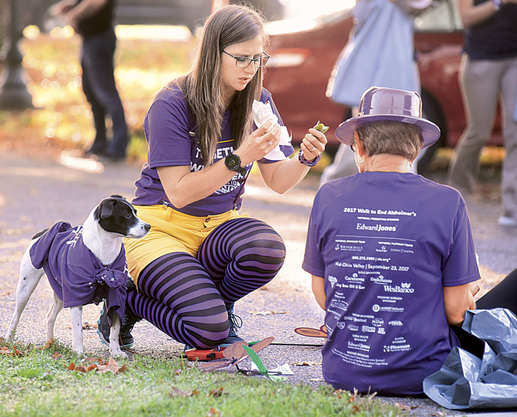 Photo by Jeff Baughan Ashley Hall, center,  of Lowell, sits with her dog, Josie, and her aunt, Linda Greathouse of Bridgeport, before Saturday's Walk to End Alzheimer's at Tomlinson Park in Williamstown.