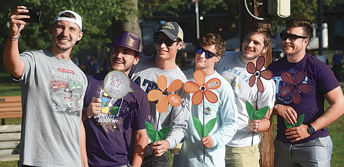 Photo by Jeff Baughan Alpha Tau Omega fraternity members of Marietta College, from left, Garret LeGraen, Jake Duvall, Nick Trocano, Daniel Blaine, Josh Daniell and Alec Bianchi, pose for a selfie Saturday. The fraternity brothers were there to support the Sigma Kappa sorority, which nationally supports Alzheimer's fundraising efforts.
