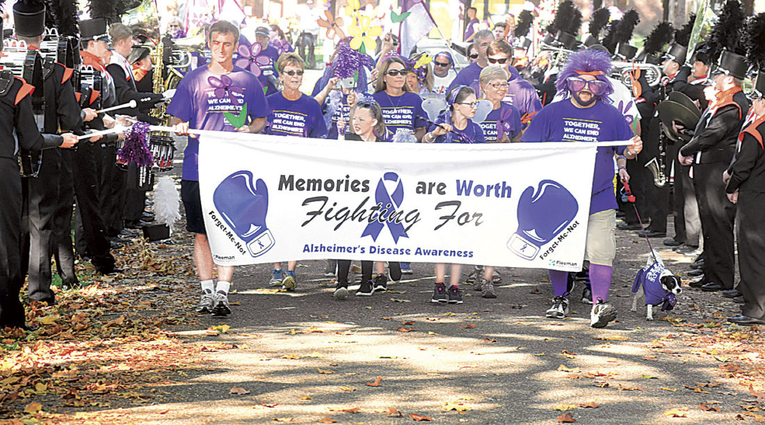 Photo by Jeff Baughan The Walk to End Alzheimer's began its trip through Williamstown by exiting through a tunnel of band members from Marietta High School at Tomlinson Park.