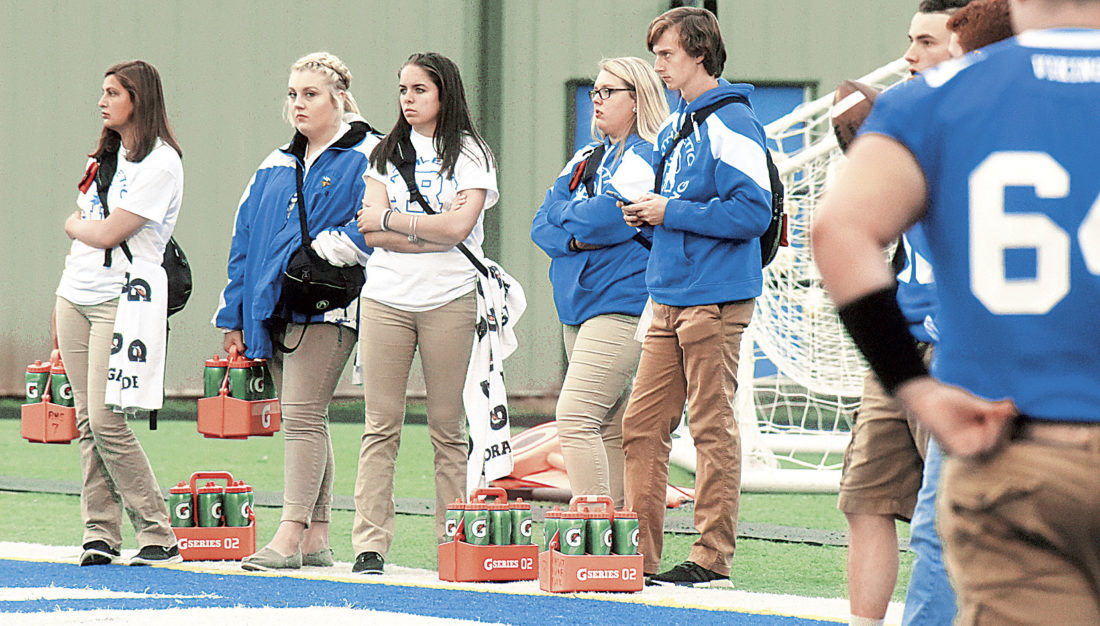 Photo by Jeff Baughan Ripley High School athletic training student assistants, from left, Kristen Yost, Anna Kimble, Kiersten Templin, Jami Crawford and Griffin Durst watch players during warmups.