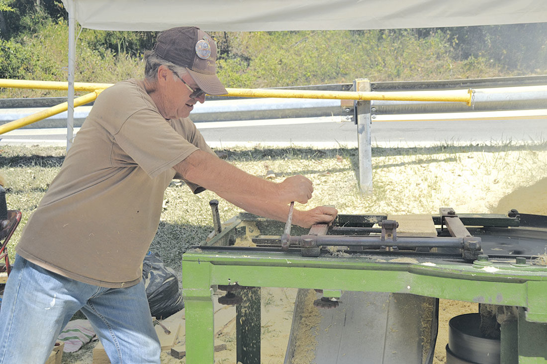 Photo by Brett Dunlap Paul Tingler, of Boaz, operates a shingle mill which was run by a tractor during the 29th annual Volcano Days at Mountwood Park on Sunday.