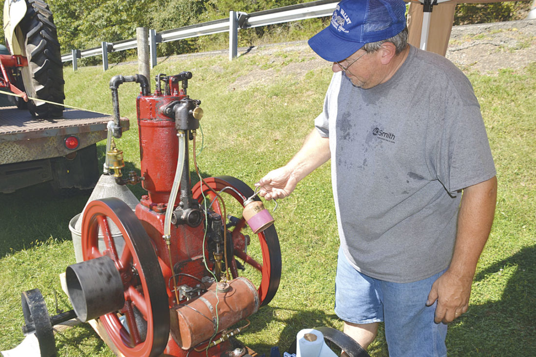 Photo by Brett Dunlap Greg Lang, of Florence, Ky., oils his 1913 International vertical hit and miss engine at the 29th annual Volcano Days at Mountwood Park on Sunday. The former Williamstown resident is still a member of the Wood County Flywheelers.