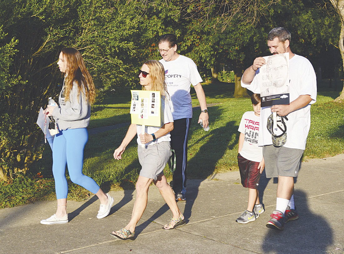 Photo by Doug Loyer A group of walkers on Front Street during the Recovery is Beautiful Walk held Saturday morning in Marietta.