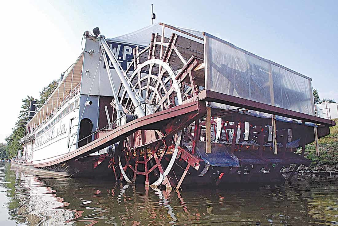 Photo by Janelle Patterson The paddlewheel  of the W.P. Snyder Jr. is covered to keep dry for a coming fresh coat of red paint during final renovations this year.